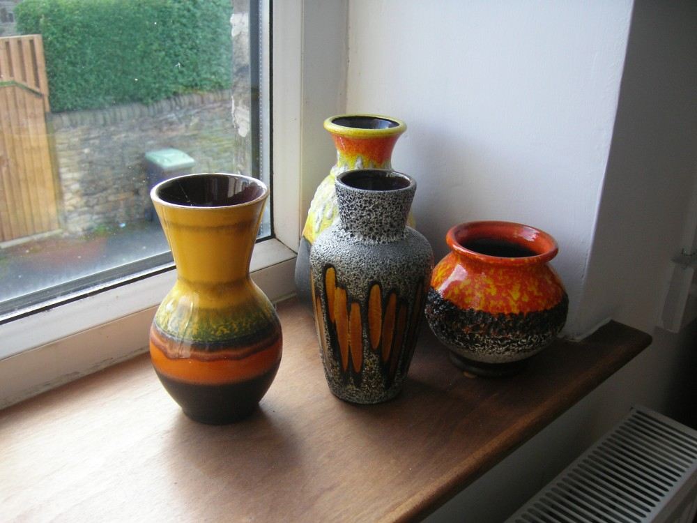 The orange and yellow collection in main bedroom windowsill