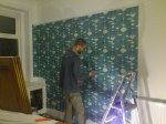 Aidan doing what he does best... wallpapering